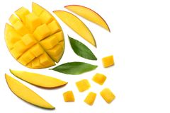 Mango slice with green leaves isolated on white background. top view stock image