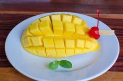 Mango slice on white plate. Stock Photos