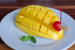 Mango slice on white plate. Stock Image