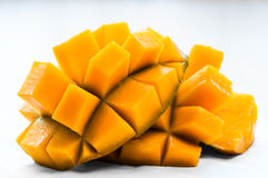 Mango sliced on the skin ready to eat organic healthy snack juicy fresh Stock Photo