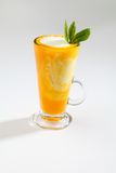 Mango slush. Cup of mango milk slush  mint leaf Royalty Free Stock Image