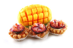 Mango and small fruit pies Stock Photos