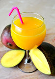 Mango smoothie. Fresh mango smoothie in a hot sunny day or in a cool spring day Stock Images