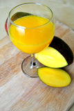 Mango Smoothie. Fresh and healthy mango smoothie in a summer hot day Stock Photos