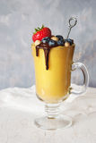 Mango smoothie and berries Royalty Free Stock Images