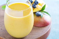 Mango smoothie on a board Stock Image