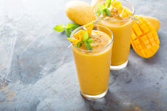 Mango smoothie in tall glasses. Refreshing and healthy mango smoothie in tall glasses Royalty Free Stock Photography