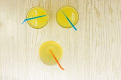 Mango smoothies, juice and fruit mango yellow on white wood from the top view.  stock image