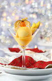Mango sorbet for Christmas. Mango and pineapple sorbet or ice cream for Christmas Royalty Free Stock Image