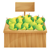 A mango stand with a wooden signboard Stock Photo
