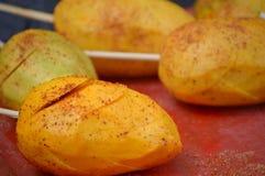 Mango on a Stick Royalty Free Stock Image