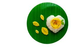 Mango sticky rice & coconut milk decorate as love shape & rose put on banana leaf royalty free stock photography
