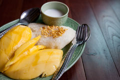 Mango and sticky rice with coconut milk on green plate | Thailand delicious sweet food. Stock Photography