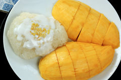 Mango and sticky rice cooked with coconut milk Stock Photography