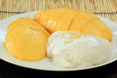 Mango and sticky rice cooked with coconut milk Stock Photo