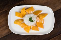 Mango sticky rice or Khaoniao mamuang on a wooden table stock photos