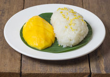 The mango sticky rice with peeled split mung bean on white plate Royalty Free Stock Photography