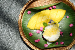 Mango and sticky rice, Sweet thai style dessert. Mango and sticky rice served with coconut milk cream and crunchy beans, Sweet thai style dessert Royalty Free Stock Photography