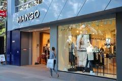 Mango store. BERLIN, GERMANY - AUGUST 27, 2014: Shopper walks by Mango fashion store at (Ku'Damm) Avenue in Berlin. Spanish fashion company Mango has 2,700 Stock Images