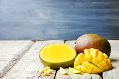 Mango. On a white wood background. tinting. selective focus Stock Image