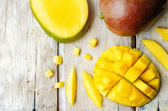 Mango. On a white wood background. tinting. selective focus Stock Photo