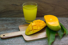 Mango on a white wood background. tinting. selective focus on the mangos slices Stock Image