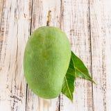 Mango on wooden background Royalty Free Stock Image