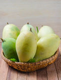 Mango on a wooden background royalty free stock images