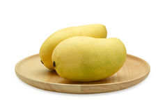 Mango in wooden plate. royalty free stock photos