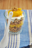 Mango Yoghurt. Yoghurt with granola and mango for breakfast royalty free stock image