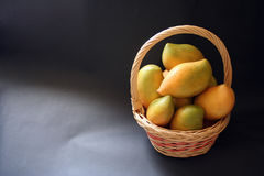 Mangoes. Fresh mangoes in a basket Royalty Free Stock Photos