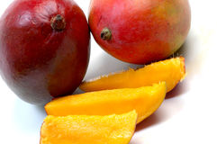 Mangoes. Juicy ripe mangoes and slices Royalty Free Stock Images