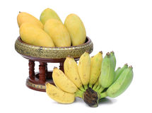 Mangoes on container. Thai style and bananas Stock Image