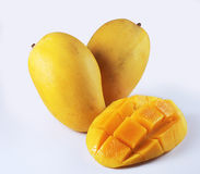 Mangoes. Two sweet mangoes and a nicely cut mango on white background Royalty Free Stock Photography