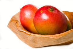 Mangoes in Wooden Bowl Stock Image