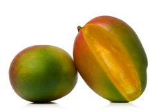 Mangos. Freshly sliced mango isolated over white background Royalty Free Stock Images