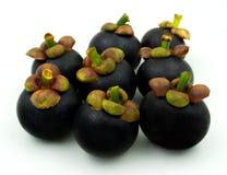 Mangostanfruchtfrucht getrennt auf weißem Hintergrund Mangostanfrüchte ist a Lizenzfreie Stockbilder