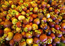 Mangosteen. Stacks of tropical fruits mangosteen royalty free stock image
