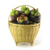 Mangosteen in basket. On white background, the tropical purple fruit in Thailand Stock Image