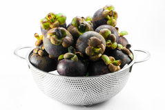 Mangosteen in the basket. Mangosteen in the aluminum basket Stock Photo