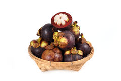 Mangosteen in basket isolate on white background Royalty Free Stock Photography
