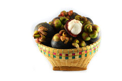 Mangosteen in the basket Stock Photos