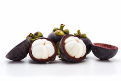 Mangosteen,cross section showing the thick purple skin. Stock Photos