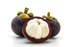 Mangosteen,cross section showing the thick purple skin. Stock Photo
