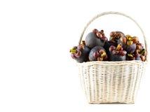 Mangosteen fruit in basket isolated on white background. Mangosteen fruit in basket isolated and white background Stock Image