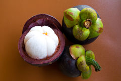 Mangosteen. Fruit on brown background Stock Photo