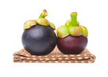 Mangosteen fruit and cross section showing the thick purple skin Royalty Free Stock Photo