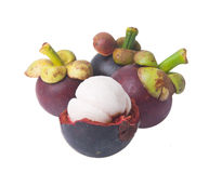 Mangosteen fruit and cross section showing the thick purple skin Royalty Free Stock Photos