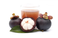 Mangosteen and juice isolated Stock Images