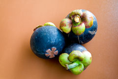 Mangosteen. Pic of mangosteen on brown background Stock Photography